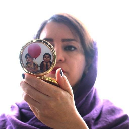 عکس دلخواه در آینه کیفی  