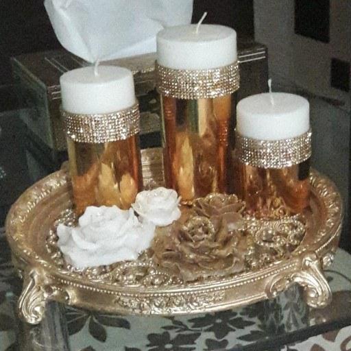 ست شمع استوانه طلایی وشمع گل رز کوچک وبزرگ وسینی جنس پلی استر طلایی |