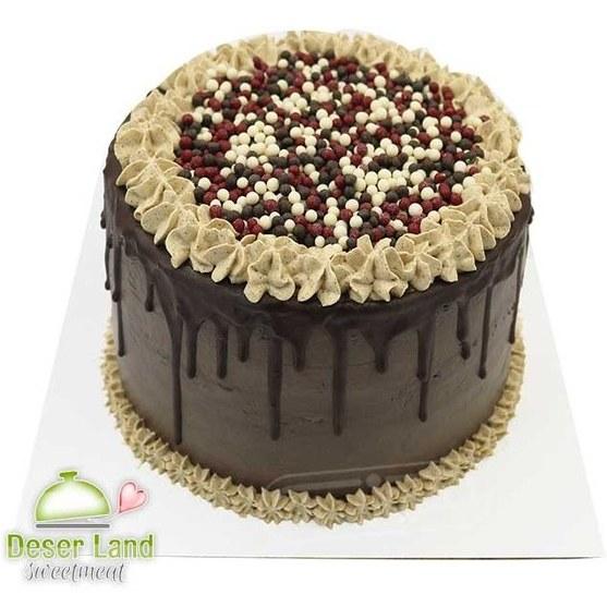 تصویر کیک شکلاتی خانگی با تزئین ترافل دسرلند