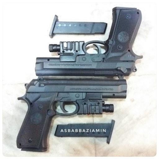 تصویر تفنگ لیزر دار اسباب بازی ساچمه ای